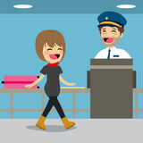 Security Check Control. Girl on security check control while policeman is inspecting baggage with x-ray machine Royalty Free Stock Image