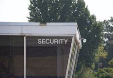 Security Guard Station Checkpoint. A security checkpoint where visitors, staff and other personnel check in with a security guard or policemen for entrance into stock photography