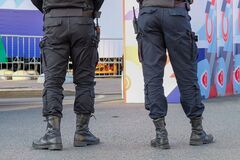 Free Security City Guards In Outfit Controlling Entrance. Policemen Trousers And Boots Of Modern Design Stock Photography - 178422332
