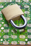 Security Computer Technology Lock. A lock on a computer circuit board stock photography