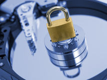 Security concept. Padlock on blue toned  hard disk drive. Security concept Royalty Free Stock Image