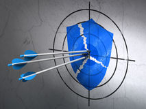 Security concept: arrows in Broken Shield target Royalty Free Stock Image
