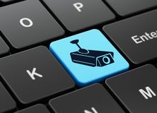 Security concept: Cctv Camera on computer keyboard Royalty Free Stock Image
