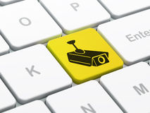 Security concept: Cctv Camera on computer. Security concept: computer keyboard with Cctv Camera icon on enter button background, selected focus, 3d render Stock Photography