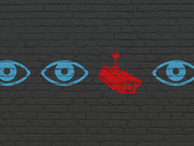 Security concept: cctv camera icon on wall Royalty Free Stock Photo
