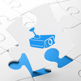 Security concept: Cctv Camera on puzzle background Royalty Free Stock Photos