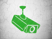 Security concept: Cctv Camera on wall background Royalty Free Stock Photos