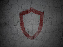 Security concept: Contoured Shield on grunge wall Stock Images