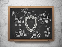 Security concept: Contoured Shield on School Board Royalty Free Stock Photo