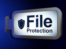 Security concept: File Protection and Shield on billboard background Royalty Free Stock Photo