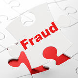 Security concept: Fraud on puzzle background Stock Photography