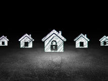 Security concept: home icon in grunge dark room. Security concept: row of Glowing home icons around home icon in grunge dark room Dirty Floor, dark background Royalty Free Stock Image