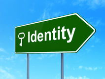 Security concept: Identity and Key on road sign Stock Photos