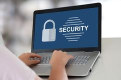 Security concept on a laptop. Woman using a laptop with security concept on the screen stock photography