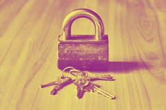 Security concept with lock and keys in duotone toned hipster style stock photography