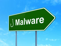 Security concept: Malware and Fishing Hook on road sign background Royalty Free Stock Photos