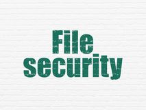 Security concept: File Security on wall background. Security concept: Painted green text File Security on White Brick wall background Stock Images