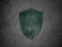 Security concept: Shield on grunge wall background Stock Photo