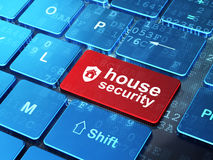 Security concept: Shield and House Security on computer keyboard. Security concept: computer keyboard with Shield icon and word House Security on enter button Stock Image