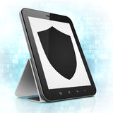 Security concept: Shield on tablet pc computer. Security concept: black tablet pc computer with Shield icon on display. Modern portable touch pad on Blue Digital Royalty Free Stock Photography