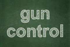 Security concept: Gun Control on chalkboard background Royalty Free Stock Image