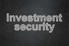 Security concept: Investment Security on chalkboard background. Security concept: text Investment Security on Black chalkboard background Royalty Free Stock Photos