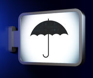 Security concept: Umbrella on billboard background Stock Image