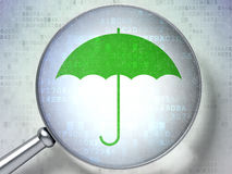 Security concept: Umbrella with optical glass on digital background Stock Images