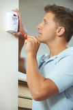 Security Consultant Fitting Burglar Alarm Sensor In Room Royalty Free Stock Image