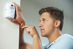 Security Consultant Fitting Burglar Alarm Sensor In Room Royalty Free Stock Images