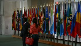 Security Council chamber United Nations Headquarters. United Nations Flags stock footage