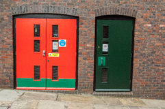 Security doors. Portrait of security doors set in brick or stone surrounds Royalty Free Stock Image
