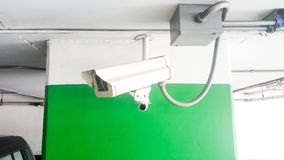 Security equipment concept. Closeup CCTV camera monitoring in the cars park. CCTV camera surveillance on car parking Safety system Stock Photos