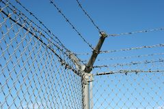 Security fence. And barbed wire royalty free stock photos