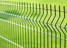 Security Fence. Background image looking at texture shape and color of thing all around us. limited depth of field was applied Royalty Free Stock Photo