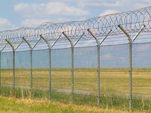 Security fence with barbedwire Stock Photography
