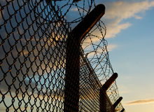 Security fencing. Against the late evening sky Stock Photography