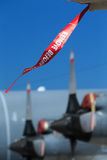 Security flag on a plane. A remove before flight flag is  placed on a plane as a security device Stock Image