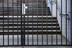 Security gate. Closed security gate with a staircase in the background Royalty Free Stock Images