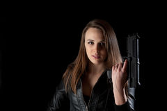 Security girl with gun Stock Images