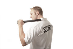 Security Guard. Isolated on white and holding a flashlight stock photography