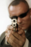 Security guard. Young men with chromed pistol, soft focus, old patina tint Royalty Free Stock Image