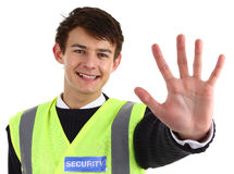 Security guard. A security guard holding out his hand, isolated on white royalty free stock photography