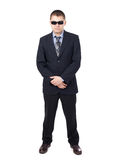 Security guard. Wearing a suit and sunglasses isolated on white background stock images