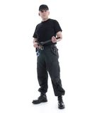 Security guard. Security man wearing black uniform holding police club in both hands standing confidently, shot on white royalty free stock photos