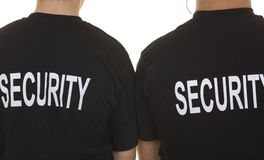 Security guard. Back of two security guards isolated on white royalty free stock images