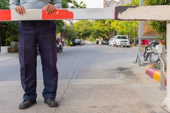 Security guard with barrier gate. For access control at gateway stock images
