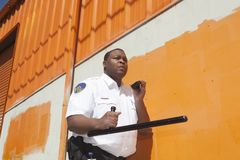 Security Guard With Baton Using Walkie Talkie Stock Images