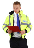 Security guard with board. A security guard with a board, checking off the list, isolated on white Stock Image