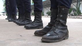 Security guard boots in line stock video footage